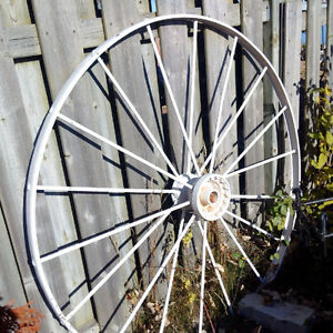 Steel wagon wheels, approx 48 inches tall set of 4 or by the pce Kingston Kingston Area image 1