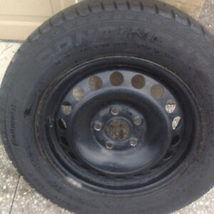 A SET OF 4 195/ 65/15 CONTINENTAL WINTER TIRES w/ STEEL RIMS