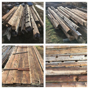 Reclaimed lumber barn boards hand hewn beams