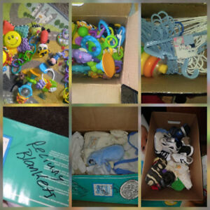 Boxs of toys shoes hangers blankets