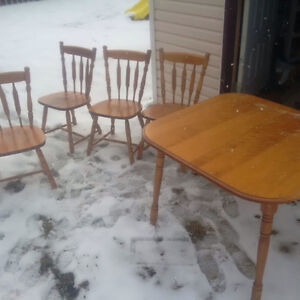 Table and chairs with an extension,