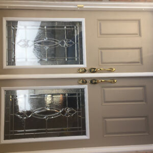 Entry doors with inserts and locks