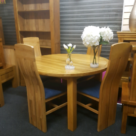 Oak furniture land extending table and chairs