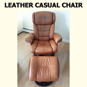 LARGE SWIVEL GENUINE LEATHER CHAIR WITH MATCHING OTTOMAN