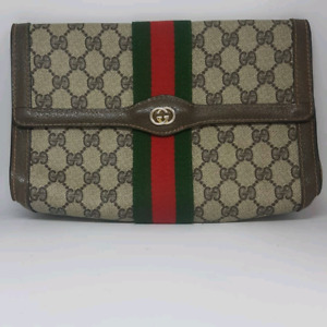 AUTHENTIC GUCCI CLUTCH  WONT LAST paid $1200!!  very rare