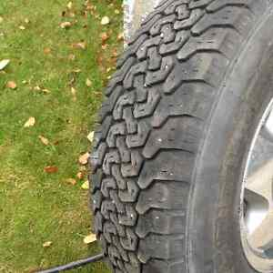 Four winter LT235/R16 tires on rims Prince George British Columbia image 2
