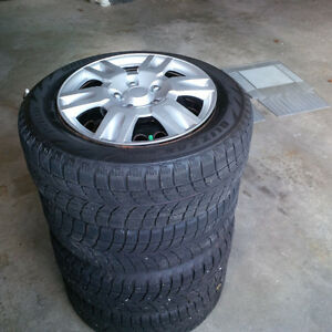 "16"" Bridgestone Blizzak Snow Tires on Rims with Hubcaps"
