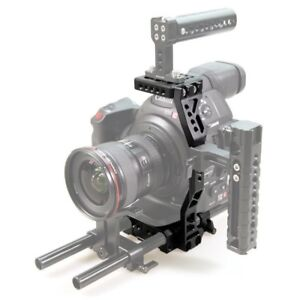Canon C100 baseplate, cage and helmet. Smallrig