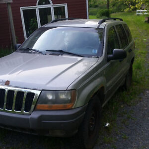 Willing to trade a 2002 jeep grand cherokee