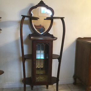 Antique display cabinet with leaded glass doors
