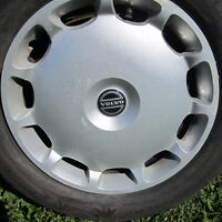 FOUR VOLVO WINTER HUBCAPS