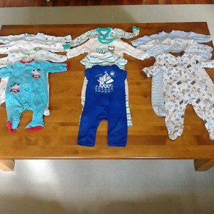 Lot of boys onesies starting at 6 months