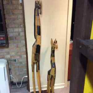 2 wooden carved giraffes