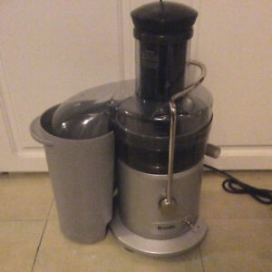 "Breville juicing machine with large  3"" opening. Excellent"