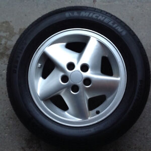 Michelin All Season tires with rims.