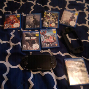 Ps vita OLED with games, power cord, case