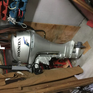 Honda 9.9 electric start, long shaft.