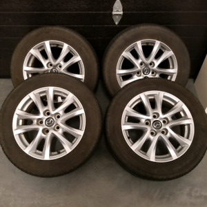 205/60/16 2015 mazda3 oem mags tires 7/32