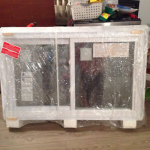 48 x 30 slider window with j-trim and brick mould