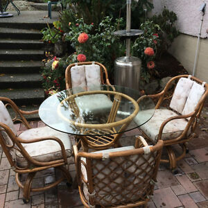 Rattan Table and Four Wheeled Chairs