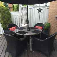 Patio set, table, 4 chairs, and umbrella included