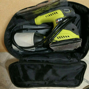 Electric sander with carry case