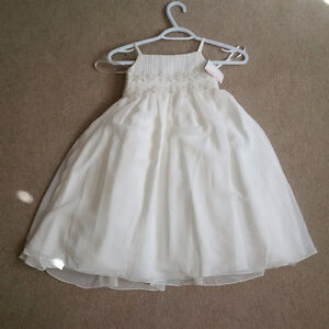 Two flower girl dresses, never worn, tag on