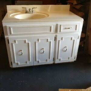Bathroom vanity with offset sink (Taps included).
