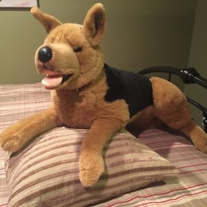 Stuffed German Sheppard with red leather collar