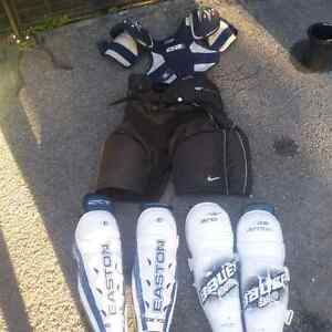 Assorted hockey equipment. 30$ takes it all