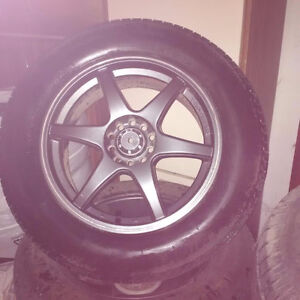 Michelin Winter X-Ice tires and Top Gun Metal Rims