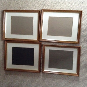 four matted picture frames