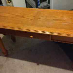 Solid wood 4 piece coffee.end tables and chesterfield table.