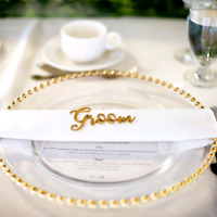 Gold glass beaded charger plates for rent