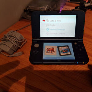New Nintendo 3DS XL with Charger and Super Mario 3D Land
