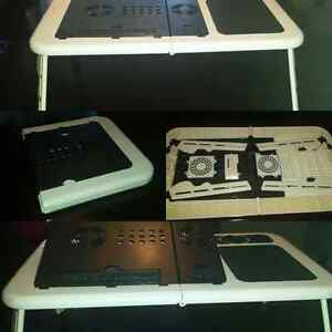 Fully adjustable portable laptop stand w/built in cooling fans.