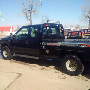 2001 Ford F350 with 7.3L diesel and new deweze bale deck
