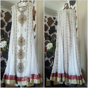 white dress embroidered  hand work