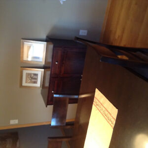 Dining table with 6 chairs and cabinet