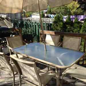 Patio  table,  6 chairs, umbrella and umbrella stand