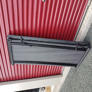 Tri-fold tonneau cover for 8 foot truck box..1/2 ton.