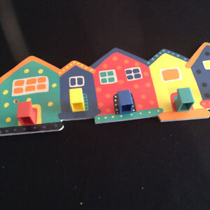 Colourful house hanger and wine cosy
