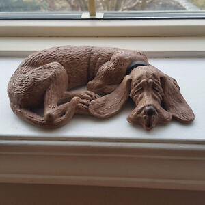 Small sleeping dog statue. Hush puppy.