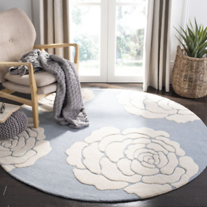 Gorgeous light blue and ivory 6' round area rug - new in package