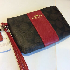 COACH Wristlet . Black / Red Leather
