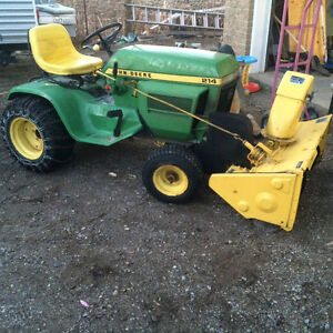 John Deere 214 garden tractor. With snowblower and chains.