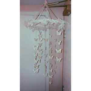 Home made pastel pink butterfly mobiles