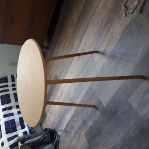 Small, round wooden table