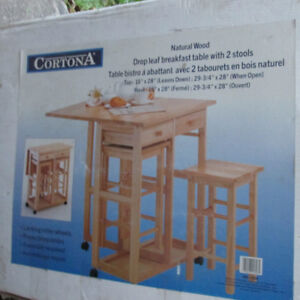 Natural wood drop leaf breakfast table with 2 stools.  Brand New