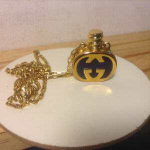 1980s. Vintage Gucci Navy and Gold Perfume Bottle Pendant Neckla